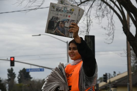 Cherry Avenue Middle School student Melissa Castillo, 14, sells Kids Day newspapers on the corner of  Blackstone Street  and Cross Avenue to benefit Valley Children's Hospital.