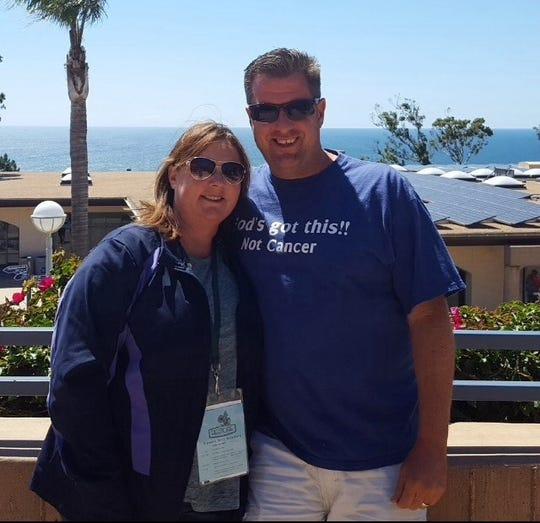 Jeff O'Neal with his wife Kim O'Neal.