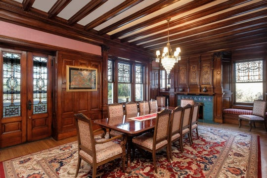 The dining room in The Crow's Nest in Bronxville. The home, designed in the 1800s, has many of its original features, including stained glass and woodwork.