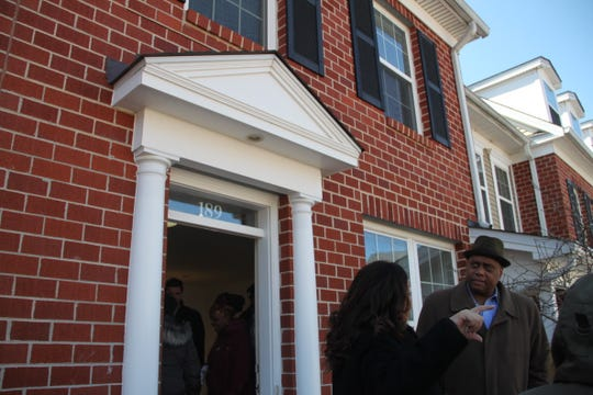 John Hill, director of the Wilmington Housing Authority, visits a sample unit of a redeveloped Annapolis affordable housing complex.