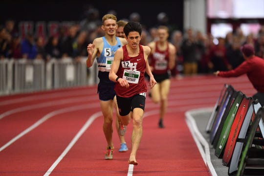 Wilmington Charter graduate Kieran Tuntivate from Harvard leads the field in the Ivy League Heptagonal 3,000 meters on the Harvard track after losing a shoe.