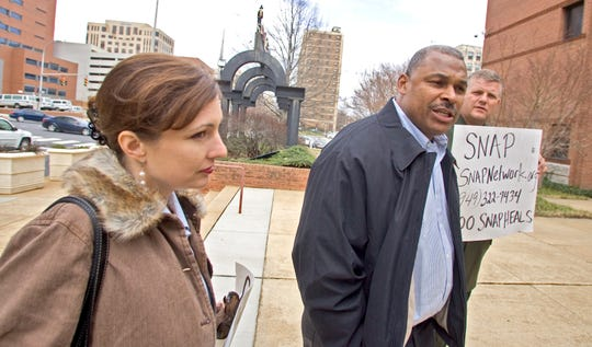 Former Eagles linebacker Al Chesley, center, Paul Livingston, and Joelle Casteix, front, of SNAP, Survivors Network of those Abused by Priests  meet at the steps of the Public Safety Building in Wilmington to show their support for the police informing more about the Delaware Child Victims Act  March 5, 2008.