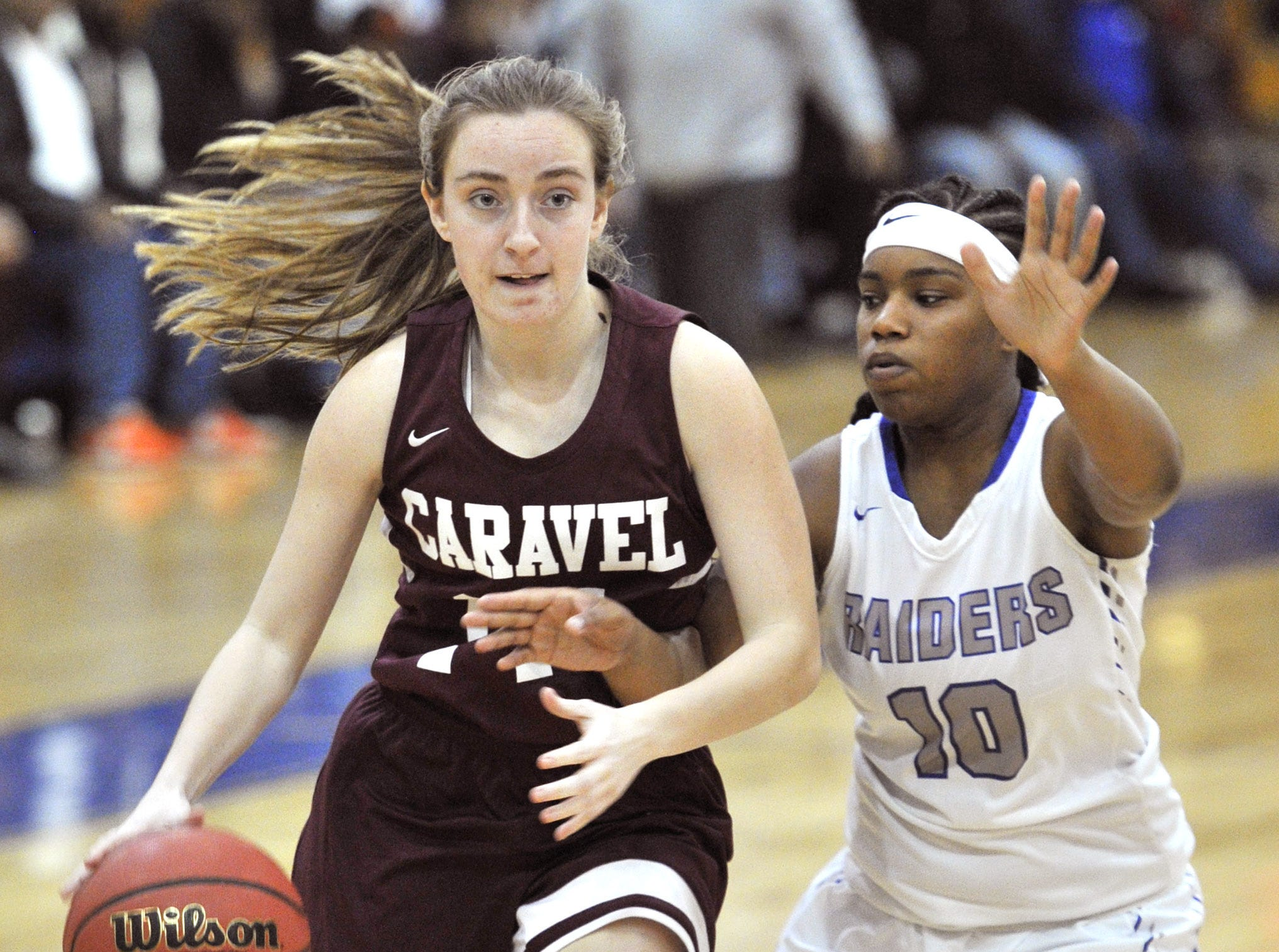 Caravel's Miranda Parretta brings the ball up court with Tykeya Nelson trying to steal..  GARY EMEIGH/Special To The News Journal
