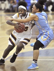 Dania Cannon of Cape tries to stop Ber'Nyah Ward-Mayo of St. Elizabeth.