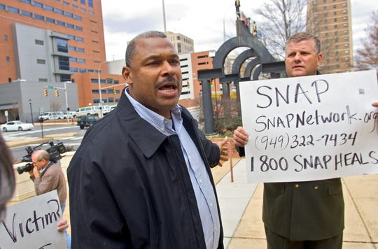 Former Eagles linebacker Al Chesley, left, and Paul Livingston, right, talk in front of the Public Safety building about the need to keep victims of abuse informed about the laws involving the Delaware Child Victims Act.  March 5, 2008.