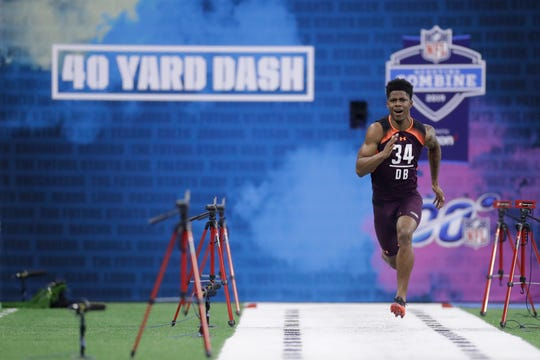 LSU defensive back Greedy Williams runs the 40-yard dash during the NFL football scouting combine, Monday, March 4, 2019, in Indianapolis. (AP Photo/Darron Cummings)