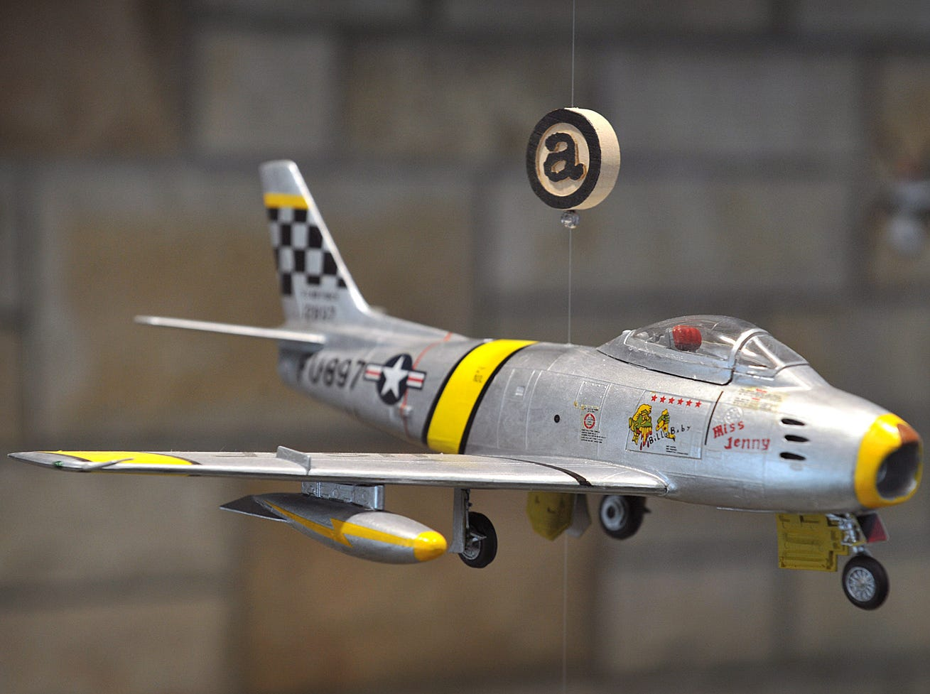 The F-86 Sabre was one of the earliest jet fighter aircraft used by the U.S. Air Force in the 1940s, and this scale model is one of 20 different planes displayed at the Hometown Combat Aviation Heroes and their Planes exhibit at the Wichita Falls Regional Airport.