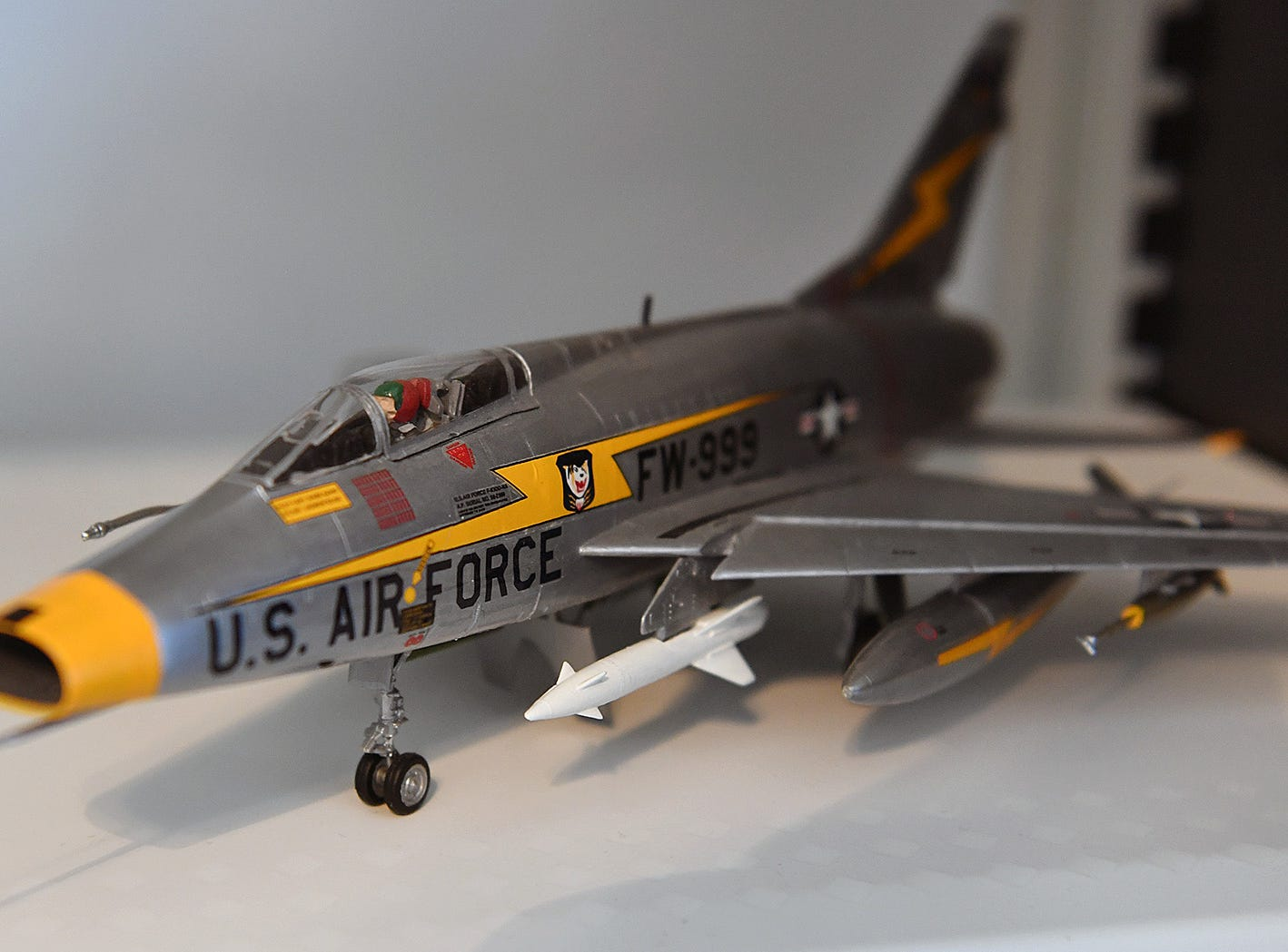 A highly-detailed F-100 Super Sabre fighter jet model built by retired Air Force veteran Jack Riddle. The F-100 was the first supersonic aircraft in the U.S. Air Force.