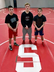 Sheridan's Chance King, left, Owen Loughman and Jordan Barnett will wrestle in the Division II state championships later this week. All have brothers who also once qualified for the Generals.