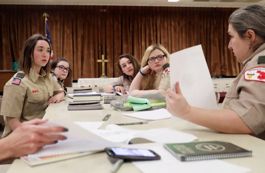 Muskingum Valley Council Scout Troop 1158 talks about the design for their kerchief during their second meeting on Monday. The all-girl troop is one of the first in the area.