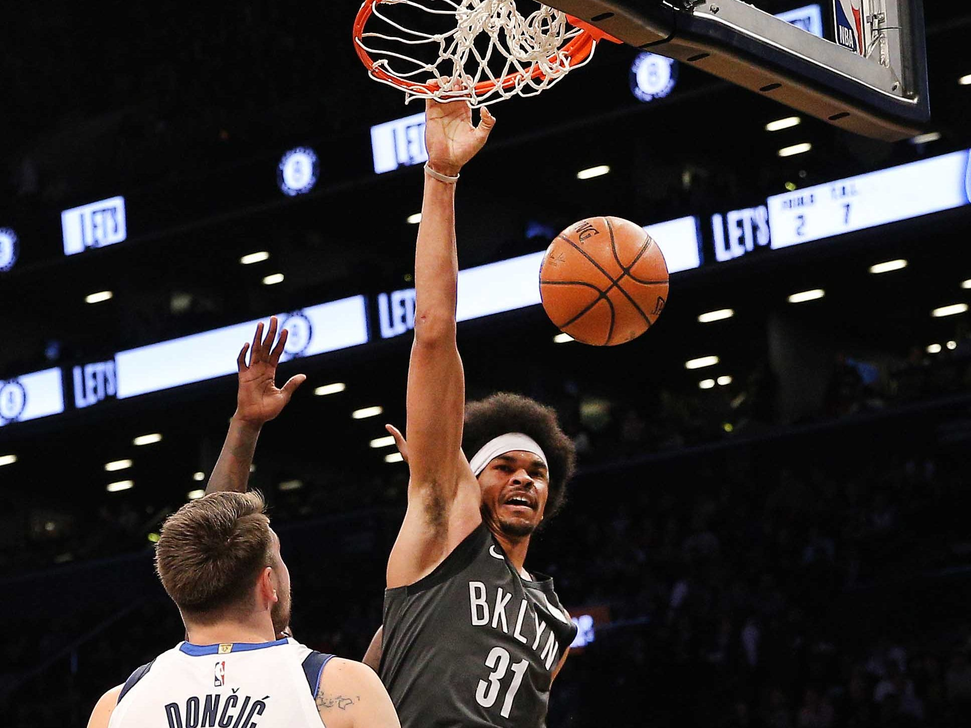 March 4: Brooklyn Nets center Jarrett Allen dunks the ball as Dallas Mavericks forward Luka Doncic looks on during the first half at Barclays Center.