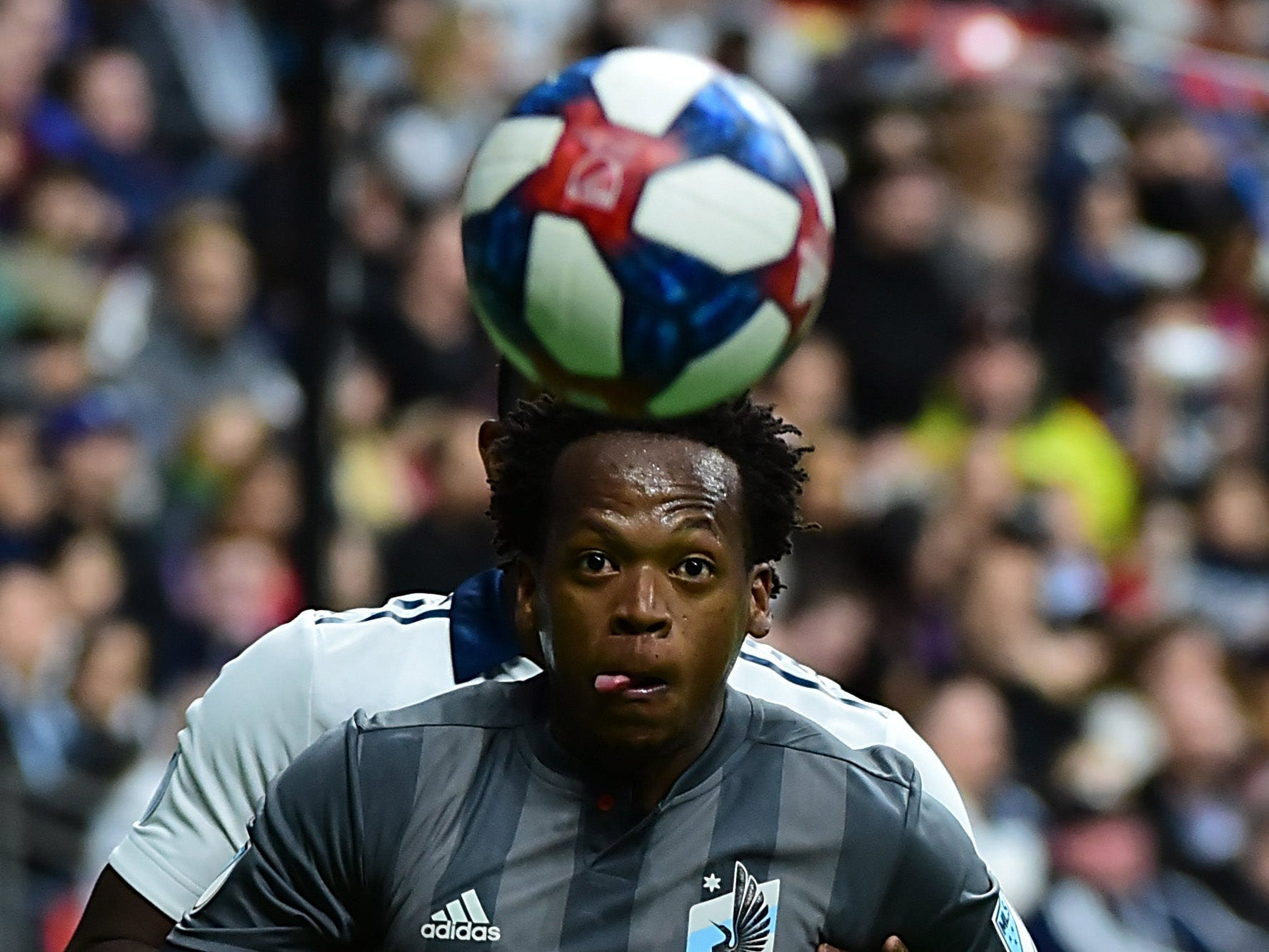Minnesota United midfielder Romario Ibarra watches the ball during the game against the Vancouver Whitecaps at BC Place. Minnesota won the game, 3-2.