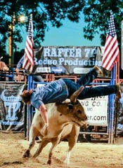 A contestant gets flipped by a bull during a Cowboy Pinball event in Missouri in June 2018.