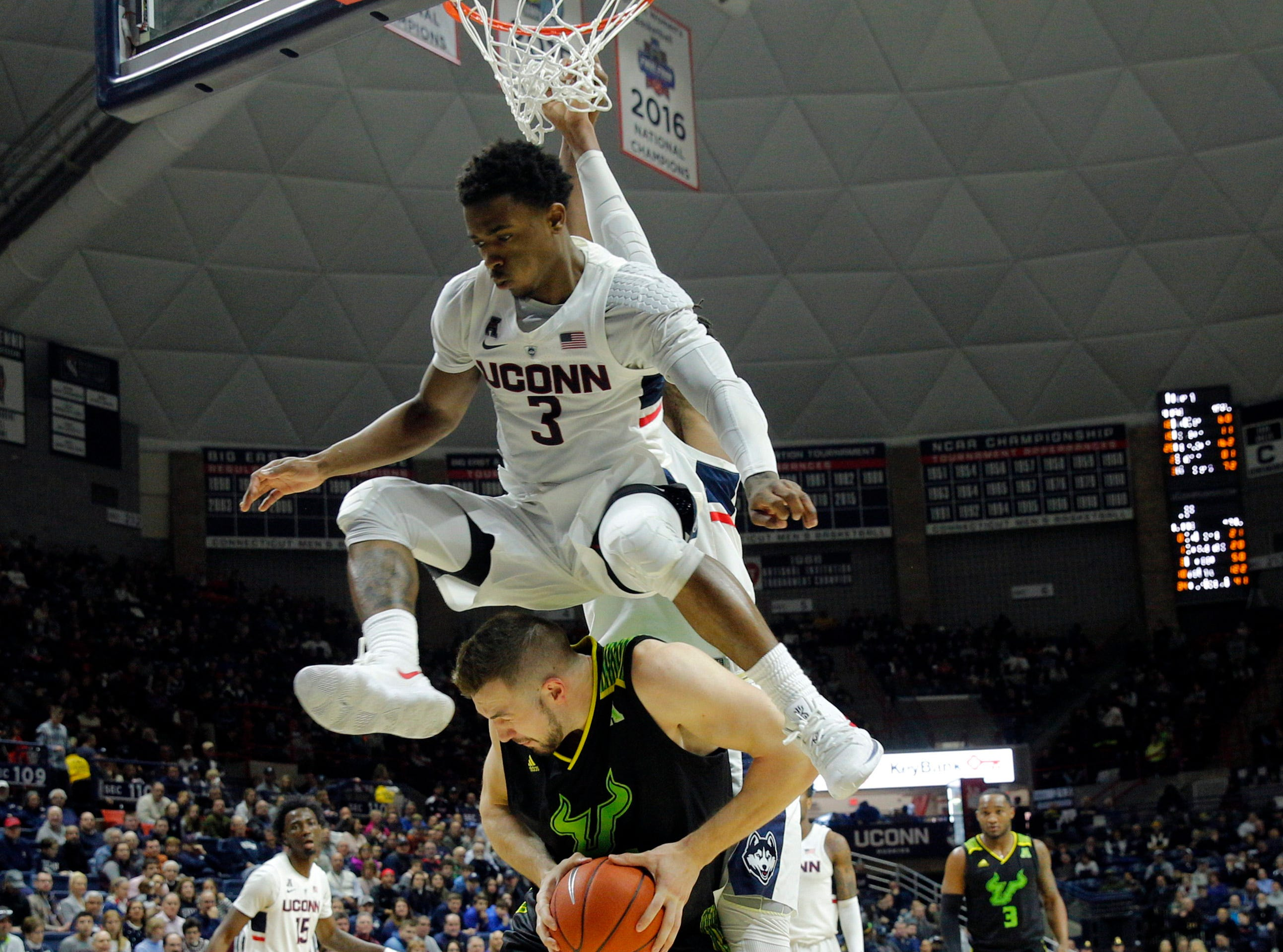 March 3: Connecticut Huskies guard Alterique Gilbert (3) defends against South Florida Bulls forward Antun Maricevic (34) in the second half at Gampel Pavilion.
