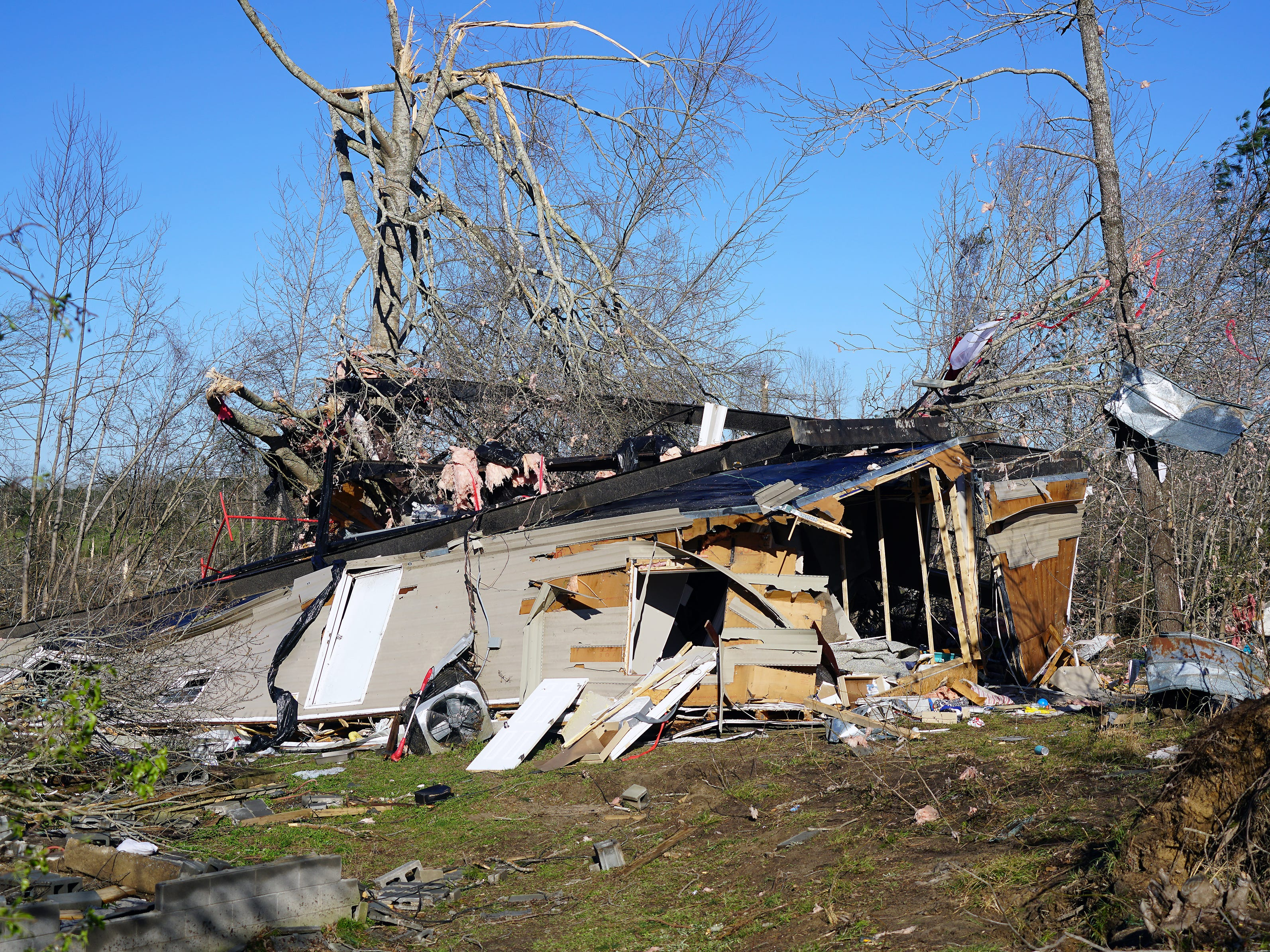 The remnants of Steve Whatley's house on March 5, 2019, where he and his family, along with a friend, sought refuge during the passage of the March 3 tornado in Beauregard, Ala.  A family friend grabbed a chainsaw from the wreckage to help rescue trapped survivors. Whatley's mother in law was killed when the mobile home's wall collapsed onto her.