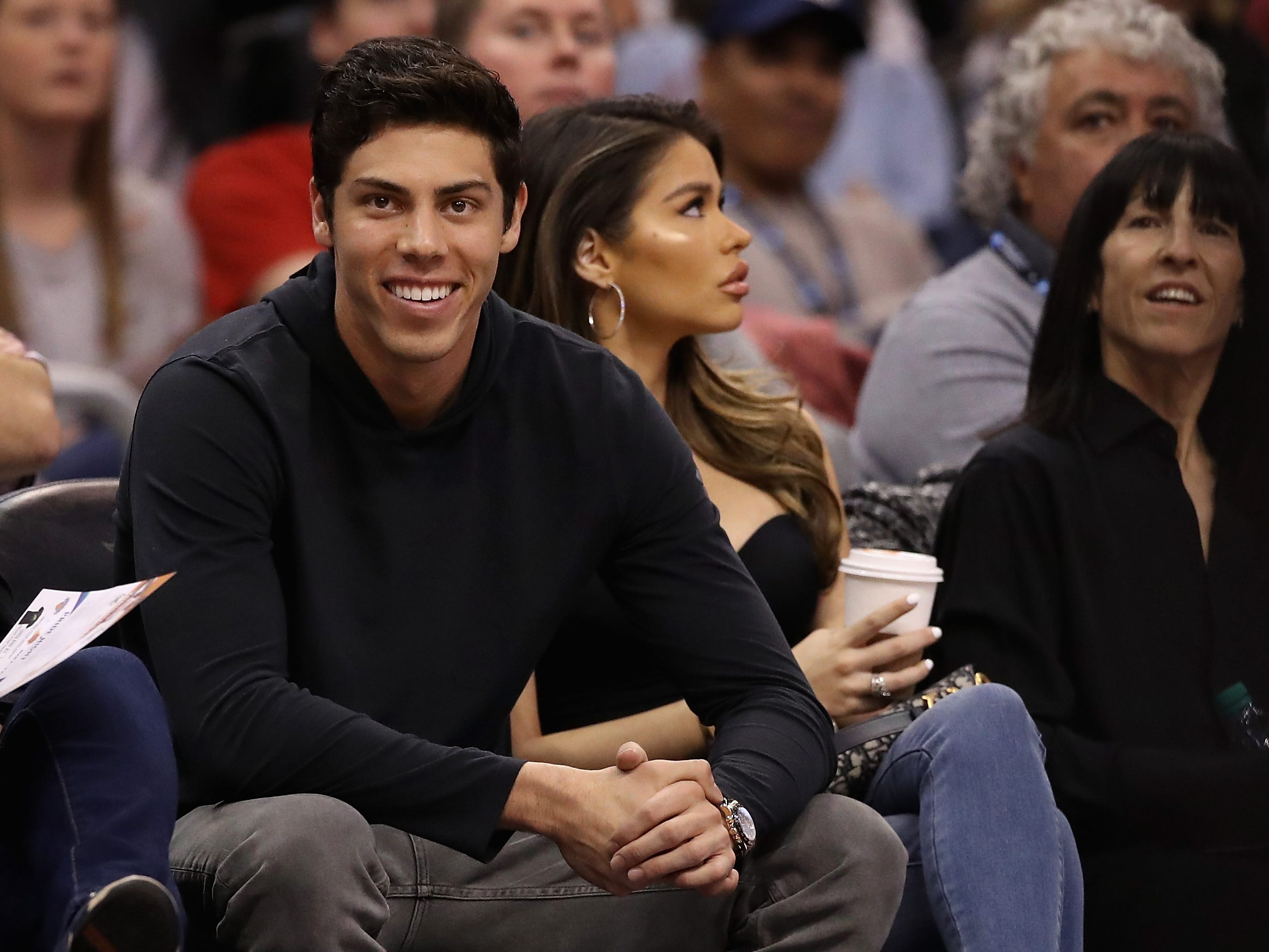 March 4: Christian Yelich of the Milwaukee Brewers attends the game between the Phoenix Suns and Milwaukee Bucks at Talking Stick Resort Arena.