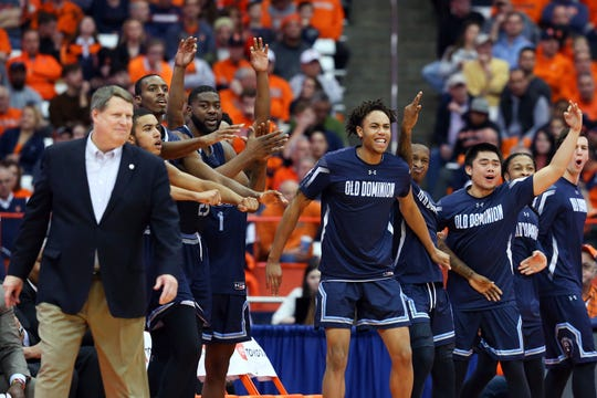 Old Dominion Monarchs players a coaches react to a made basket against the Syracuse Orange during the second half at the Carrier Dome.