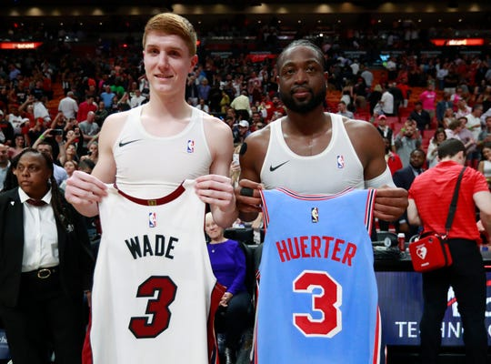7e4964ae29df Atlanta Hawks guard Kevin Huerter and Miami Heat guard Dwyane Wade swap  jerseys.