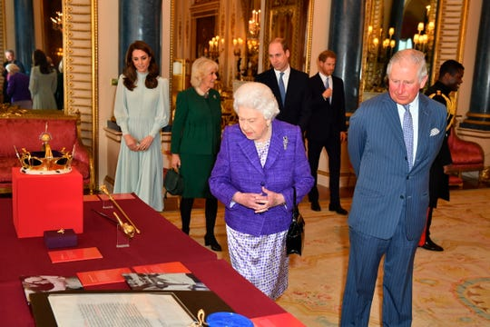 The royal family lines up to see some of the regalia from Charles' 1969 investiture ceremony.