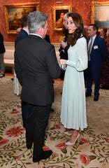 Duchess Kate wore a delicate seafoam-green long-sleeved dress for the reception.