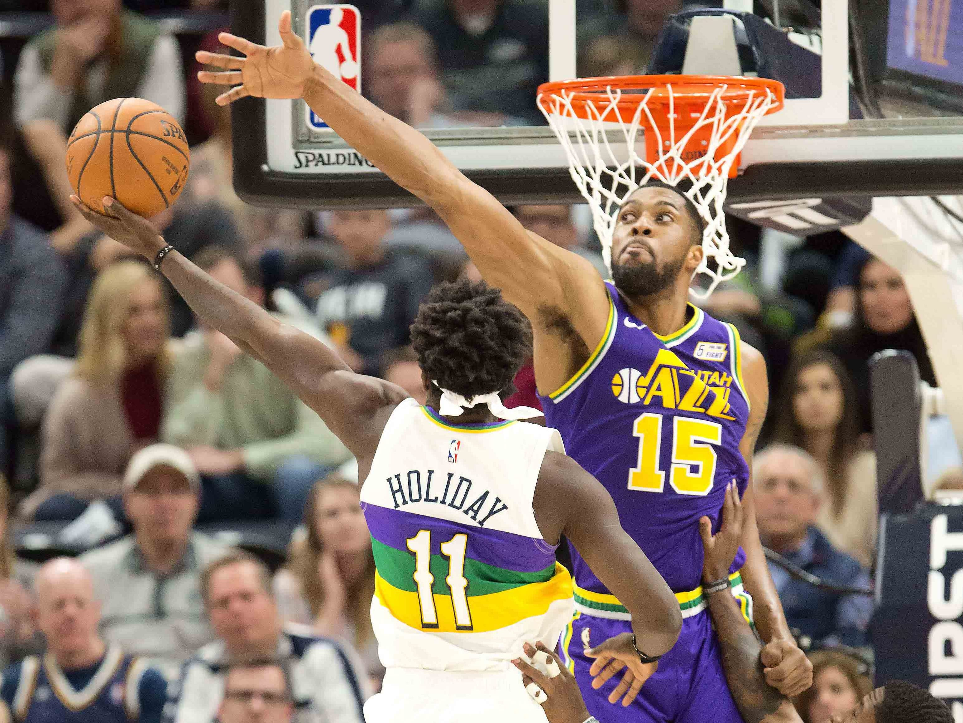 March 4: New Orleans Pelicans guard Jrue Holiday (11) shoots the ball against Utah Jazz forward Derrick Favors (15) during the second half at Vivint Smart Home Arena. The Pelicans won the game, 115-112.