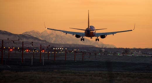 In this Feb. 24, 2019 photo, a plane takes off at Salt Lake City International Airport in Salt Lake City, Utah.  Planes at Salt Lake City International Airport hit 280 birds last year, including one incident in which a flock of birds hit a plane carrying 223 passengers and narrowly missed hitting the engine.   (Leah Hogsten/The Salt Lake Tribune via AP)