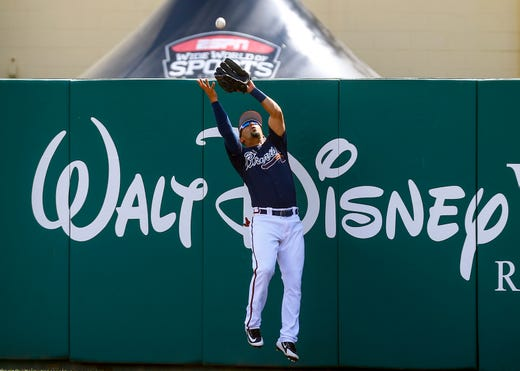 March 4: Braves right fielder Rafael Ortega leaps at the wall to catch a fly ball.