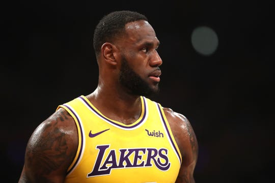 LeBron James looks on during the first half of the Lakers' loss to the Clippers.