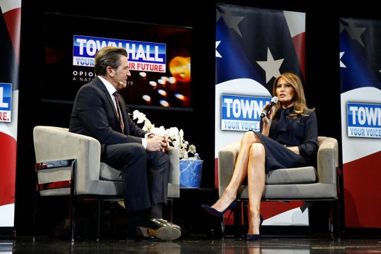 First lady Melania Trump speaks with moderator Eric Bolling at a town hall on the opioid epidemic.