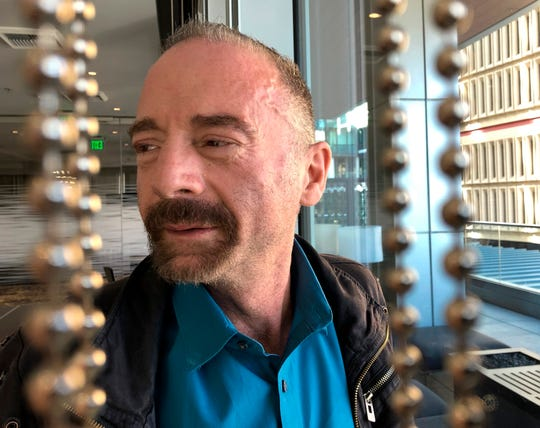 "Timothy Ray Brown poses for a photograph, Monday, March 4, 2019, in Seattle. Brown, also known as the ""Berlin patient,"" was the first person to be cured of HIV infection, more than a decade ago."