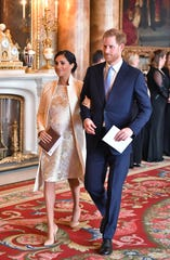 Duchess Meghan and Prince Harry make the rounds at Prince Charles' reception.