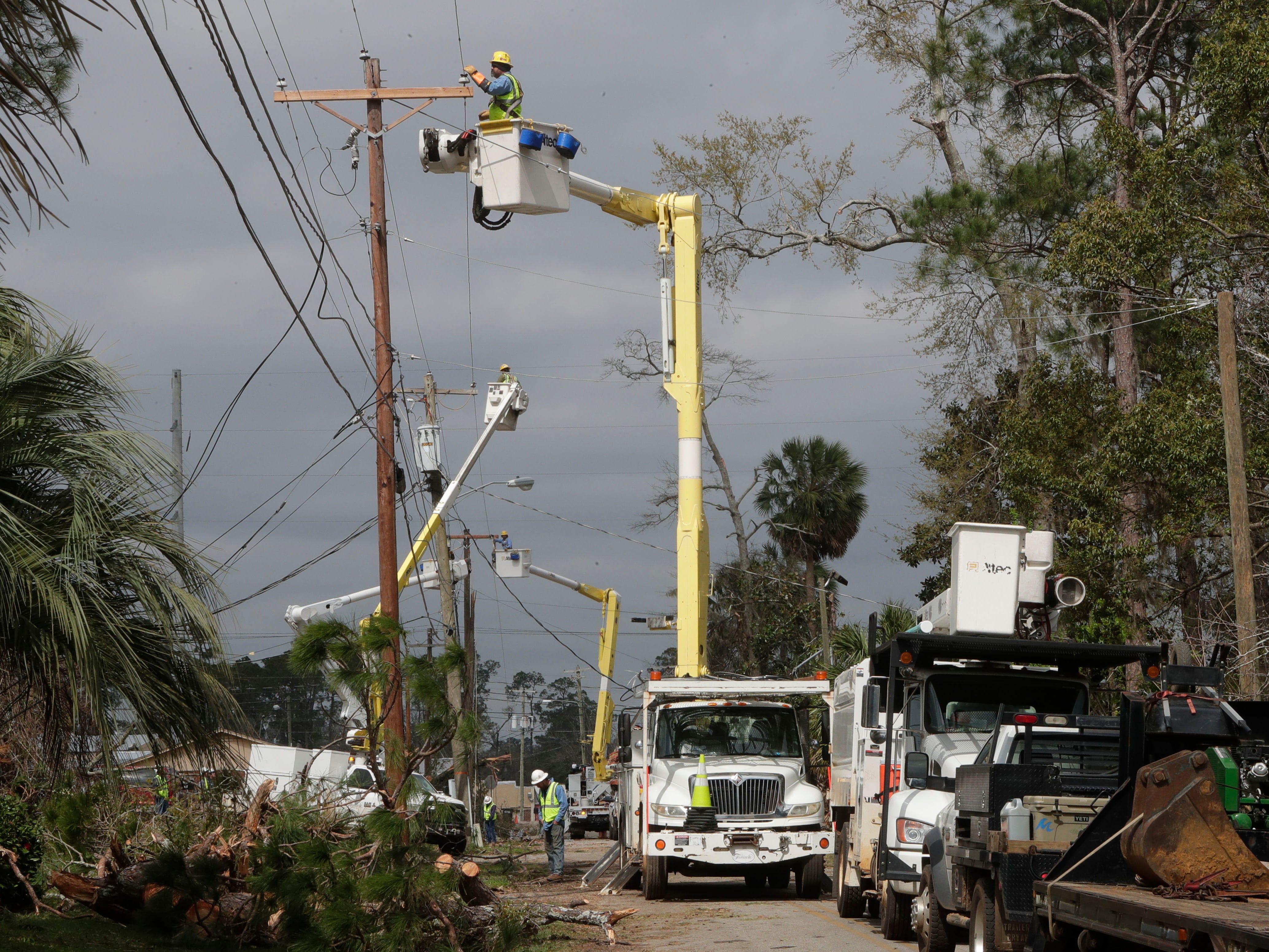 Crews work to restore power in Cairo, Ga. on March 4, 2019.