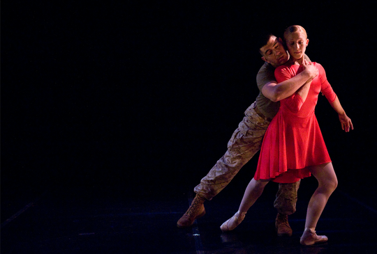 Roman Baca performs military-themed choreography with ballet dancer.