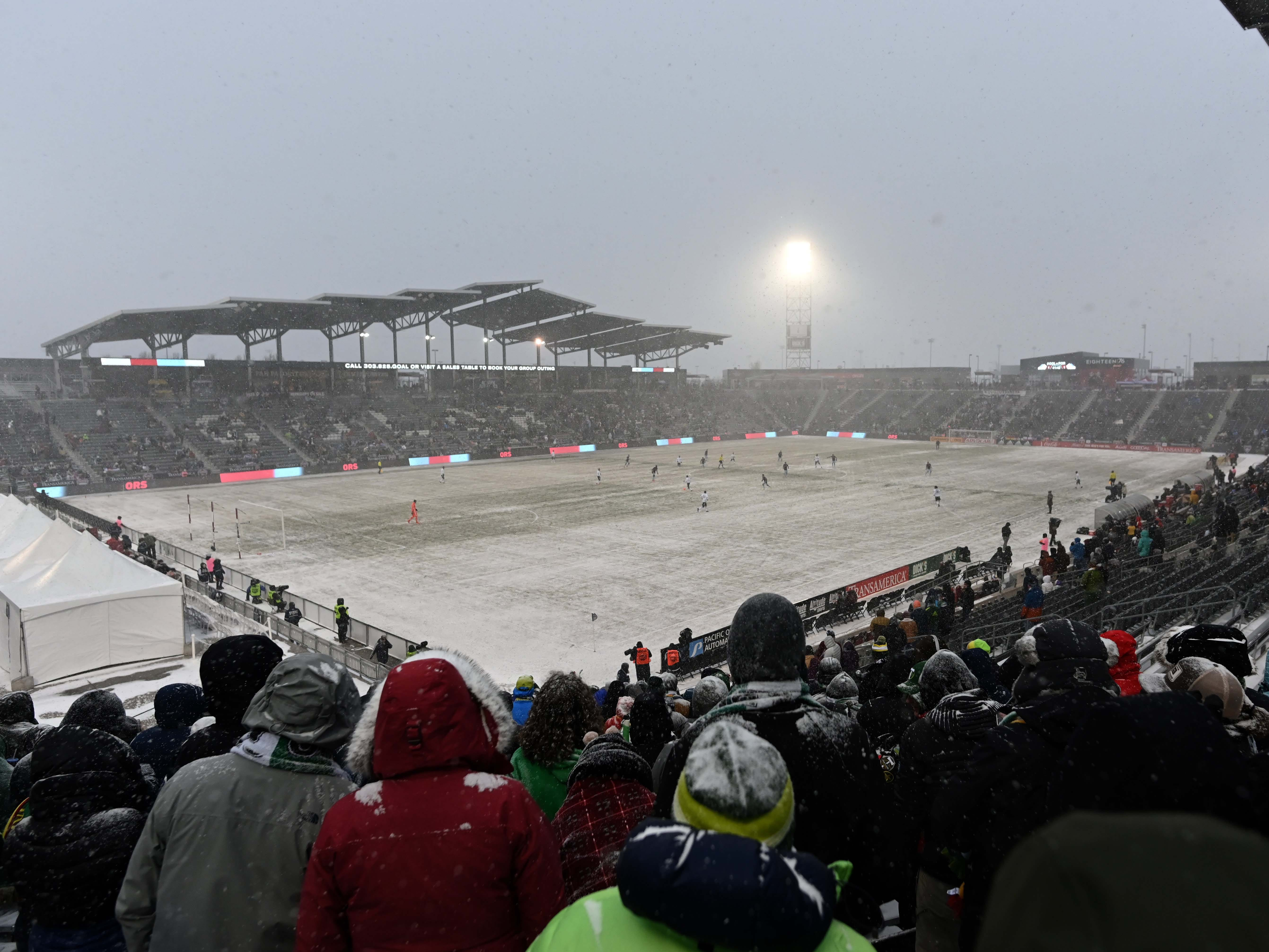 Snow falls during the first half of the match between the Portland Timbers and the Colorado Rapids at Dick's Sporting Goods Park.