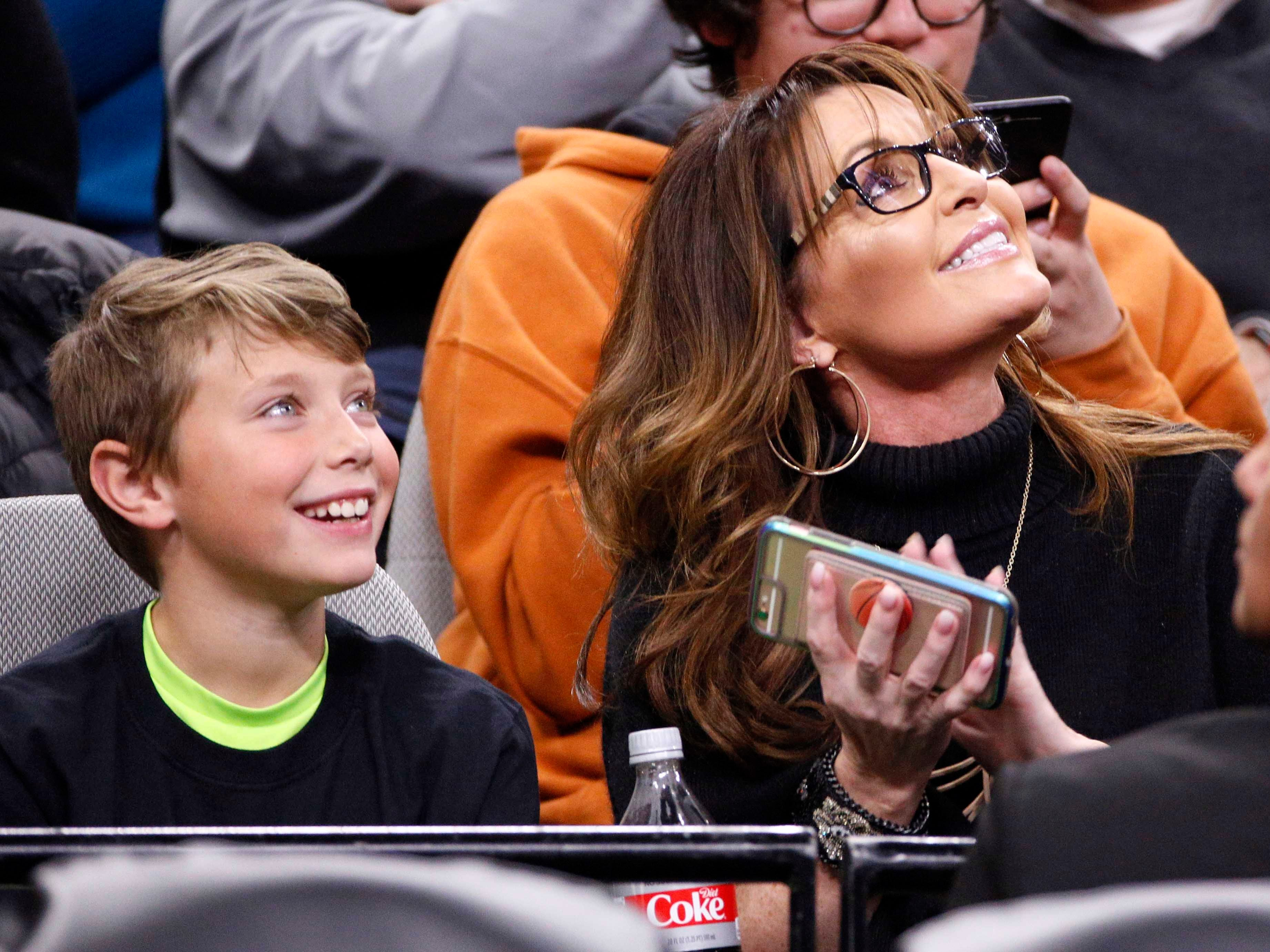 March 4: Former vice presidential candidate Sarah Palin and her grandson Tripp attend the game between the San Antonio Spurs and the Denver Nuggets at AT&T Center.
