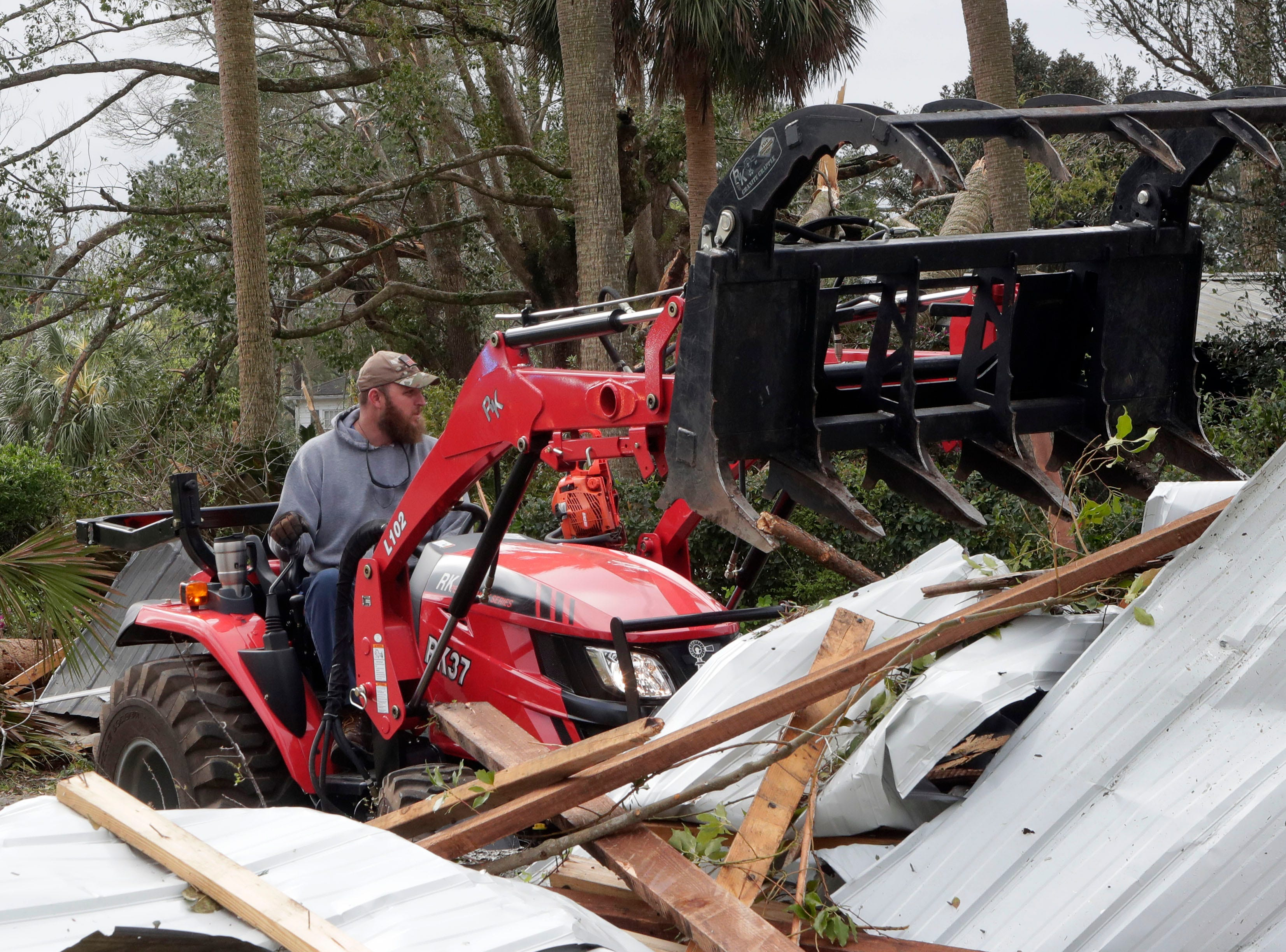 Jeremy Adams volunteers his time to help clean up debris in Cairo, Ga. on March 4, 2019.
