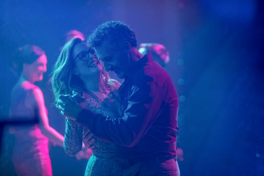 "Julianne Moore and John Turturro find love under neon disco lights in ""Gloria Bell."""