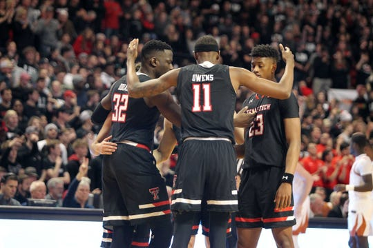 Texas Tech Red Raiders forward Tariq Owens (11) center Norense Odiase (32) and guard Jarrett Culver (23) before the game against the Texas Longhorns at United Supermarkets Arena.