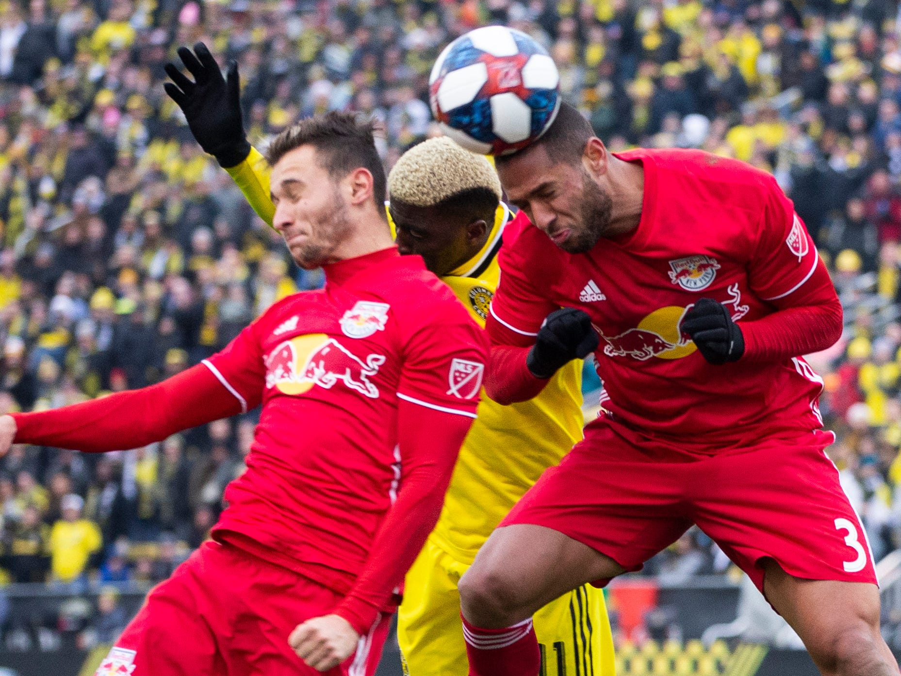 New York Red Bulls defender Amro Tarek (3) plays the ball ahead of teammate Andreas Ivan and Columbus Crew SC forward Gyasi Zardes (11) at MAPFRE Stadium. The Crew and Red Bulls played to a 1-1 tie.