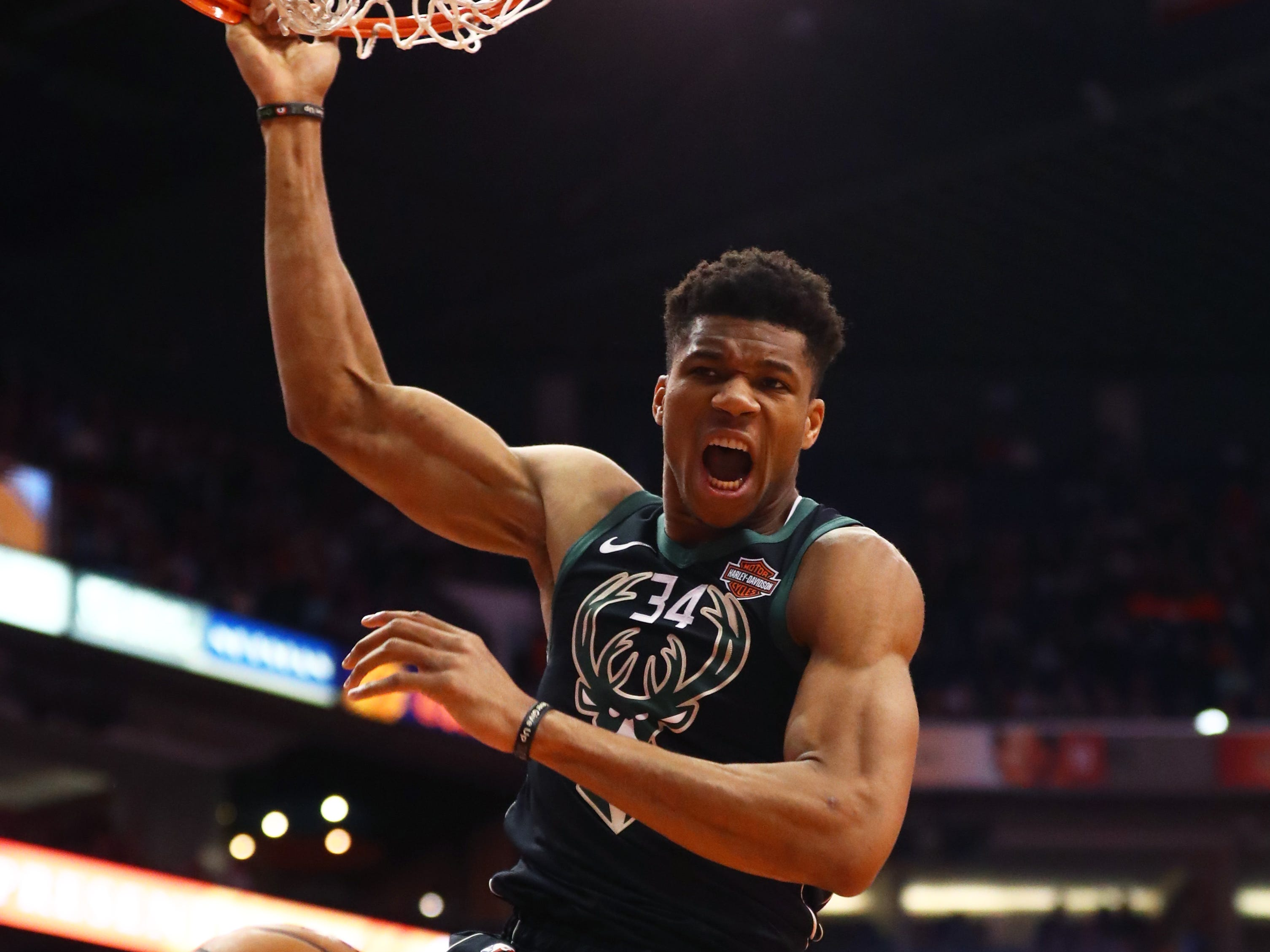 March 4: Milwaukee Bucks forward Giannis Antetokounmpo (34) reacts as he slam dunks the ball against the Phoenix Suns in the first half at Talking Stick Resort Arena.