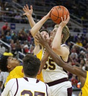 Simpson guard Cameron Bettez (55) fights through contact against Pleasant Hill Monday afternoon in the Class C State Semifinals in Burton Coliseum in Lake Charles.