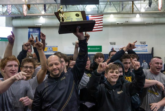 Southern, with head coach John Stout, holding the NJSIAA Group V championship plaque, is the Shore Conference Team of the Year.