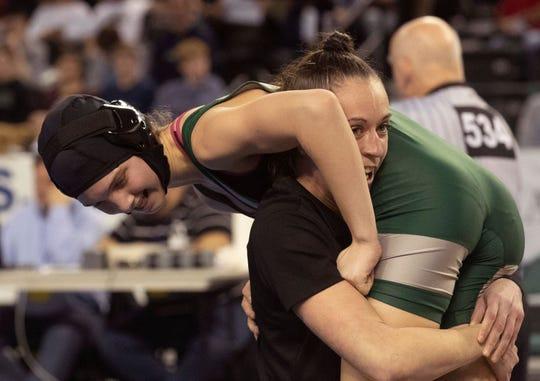 Raritan's Cristine Gavasheli is lifted up in celebration by Raritan girls wrestling coach Melissa Gardner after winning the NJSIAA girls 118-pound championship.