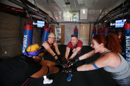 (center) Wayne Strobel, owner of Beachbox, a year-old fitness and training facility, leads a Kickboxing + Strength + Core class for (L-R) Crystal McPherson of Ocean Twp., Carol Viggiani of Spring Lake Heights and Janice Motler of Neptune City at his gym in Asbury Park, NJ Wednesday, March 6, 2019.