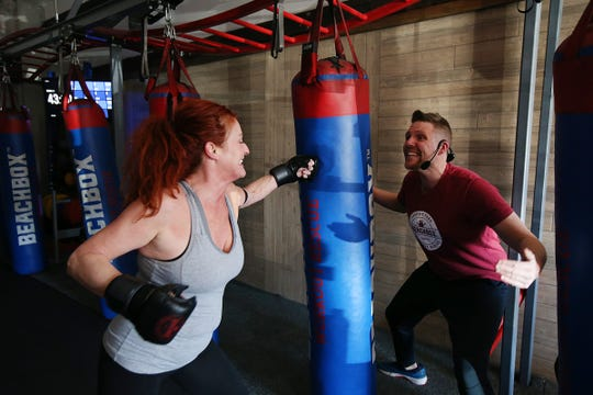 (Right) Wayne Strobel, owner of Beachbox, a year-old fitness and training facility, works with Janice Motler of Neptune City during a Kickboxing + Strength + Core class at his gym in Asbury Park, NJ Wednesday, March 6, 2019.