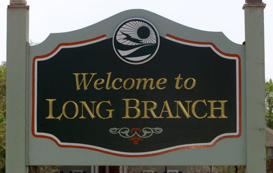 """The """"Welcome to Long Branch"""" sign along Cedar Avenue."""