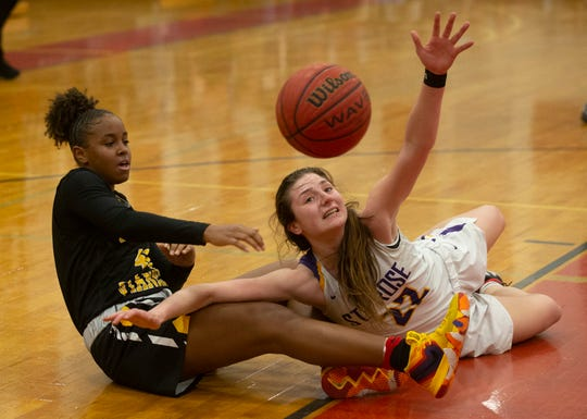 St John Vianney's Brelynn Bethany and St Rose's Brynn Farrell battle for a loose ball during closing minutes of game. St Rose Girls basketball vs St. John Vianney in Non-Public South A basketball final in Jackson, NJ on March 5, 2019.