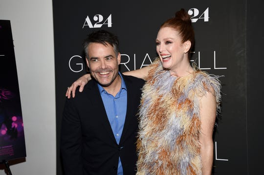 """Director and writer Sebastian Lelio, left, and actress Julianne Moore attend a special screening of """"Gloria Bell"""" at the Museum of Modern Art on Monday, March 4, in New York."""