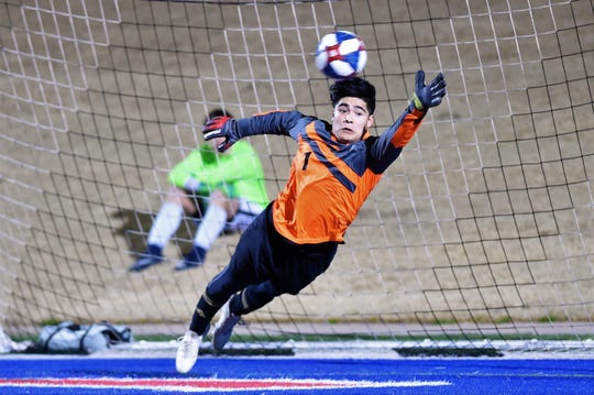 Abilene High's Bryan Bocanegra (1) attempts to save a penalty kick against Euless Trinity at Shotwell Stadium on Tuesday, March 5, 2019. Bocanegra saved a PK and scored from the spot as the Eagles came back to tie the game 2-2 in regulation and won 5-4 in penalty kicks.