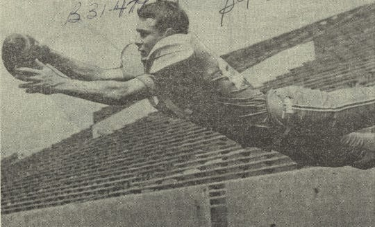 """Jon Harrison making a diving catch for a  football preview story in 1967. The caption read """"he will be a strong candidate for all-district defensive honors."""""""